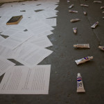 Installation view of the adhesives and texts on the floor at the Cactus Bra Space, San Antonio